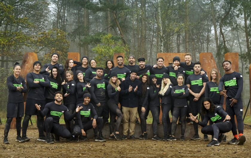 """This image released by MTV shows the current cast of MTV's reality competition series, """"The Challenge."""" Currently airing its 35th season, the coronavirus pandemic has allowed """"The Challenge"""" to draw in new viewers to its consistently loyal fanbase. This season's premiere gained its highest rating in more than 14 years. (MTV via AP)"""