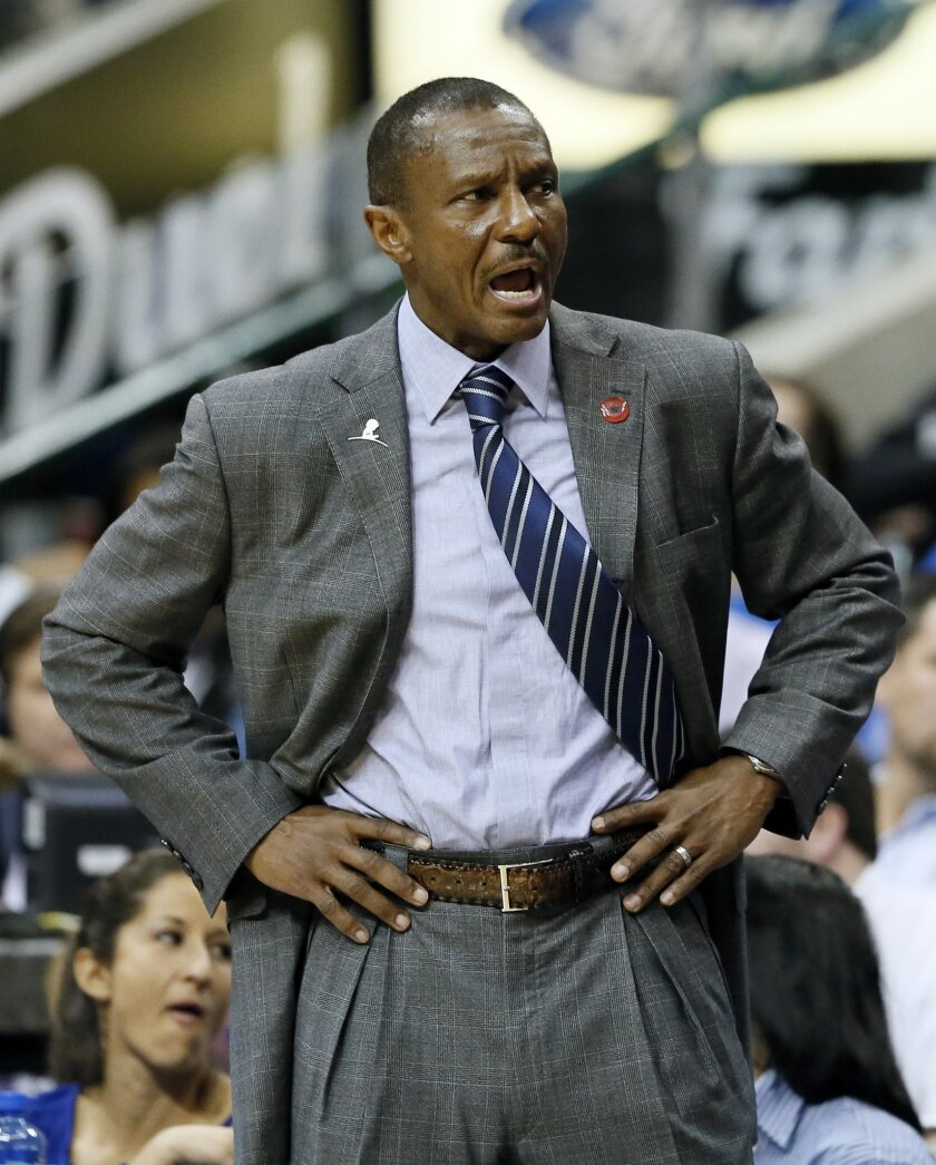 Toronto Raptors head coach Dwane Casey shouts in the direction of an official after a foul was called against his team in the first half of an NBA basketball game against the Dallas Mavericks Tuesday, Nov. 3, 2015, in Dallas.(AP Photo/Tony Gutierrez)