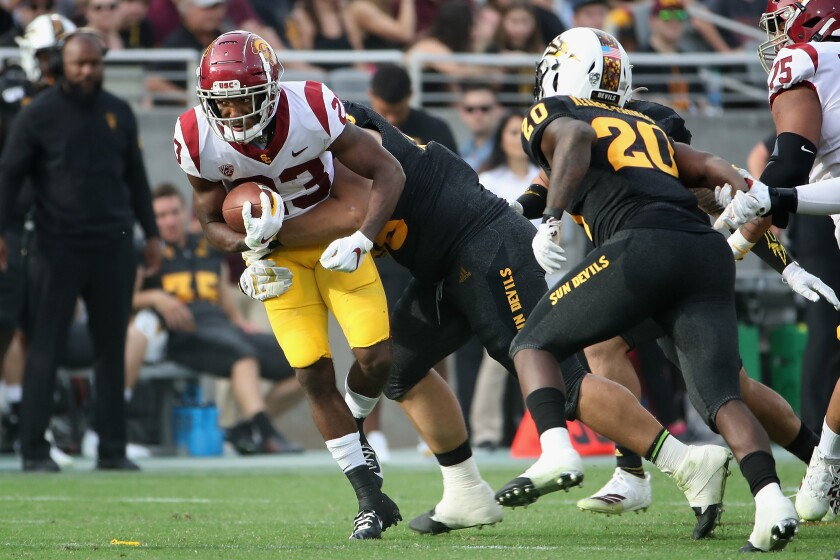 USC running back Kenan Christon carries the ball during the Trojans' win over Arizona State on Saturday.