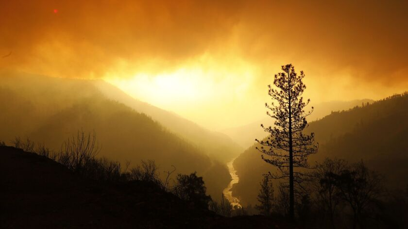 Smoke fills the sky in Butte County as the Camp fire burns along the north fork of the Feather River on Sunday.