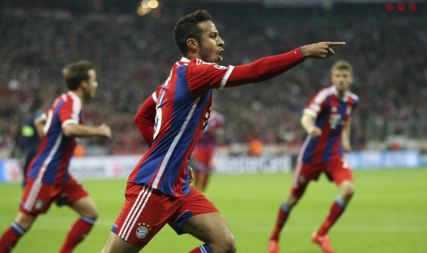 Bayern's Thiago celebrates after scoring the opening goal during the soccer Champions League quarterfinal second leg match between Bayern Munich and FC Porto at the Allianz Arena in Munich, southern Germany, Tuesday, April 21, 2015. (AP Photo/Michael Probst)