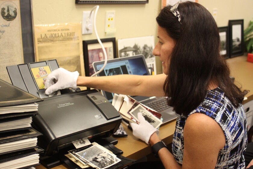Association of Personal Photo Organizers member Tammy Smith carefully scans each photo.