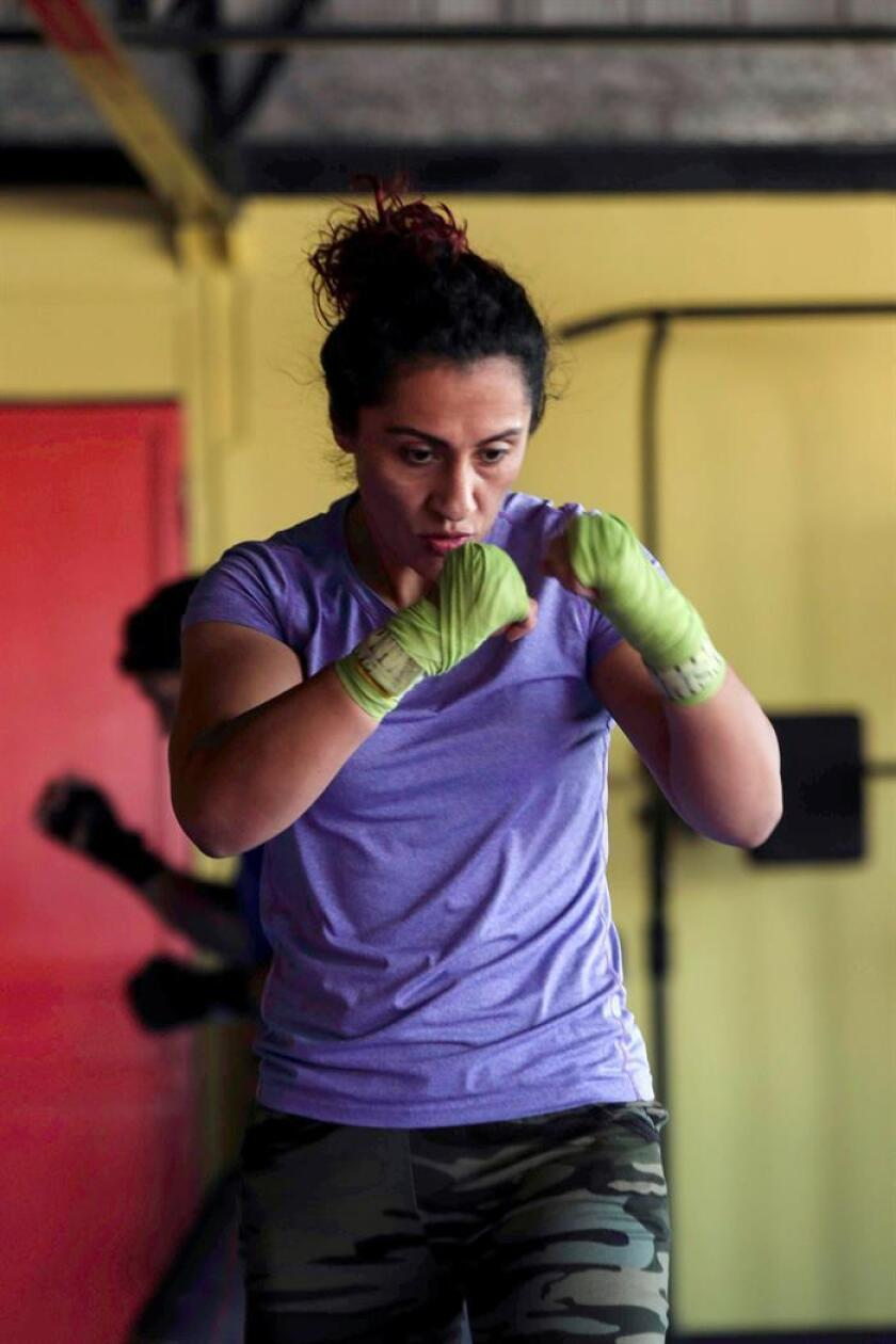 Chilean champion boxer Krespita Rodriguez is looking to restart her career three years after giving birth to a daughter. EFE-EPA/ Alberto Valdes
