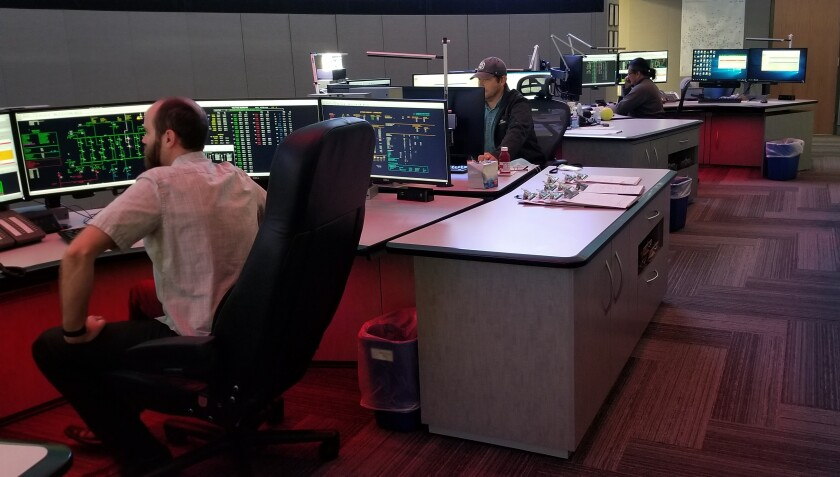 Sequestered San Diego Gas & Electric workers manning transmission system operations at mission control during the COVID-19 pandemic.