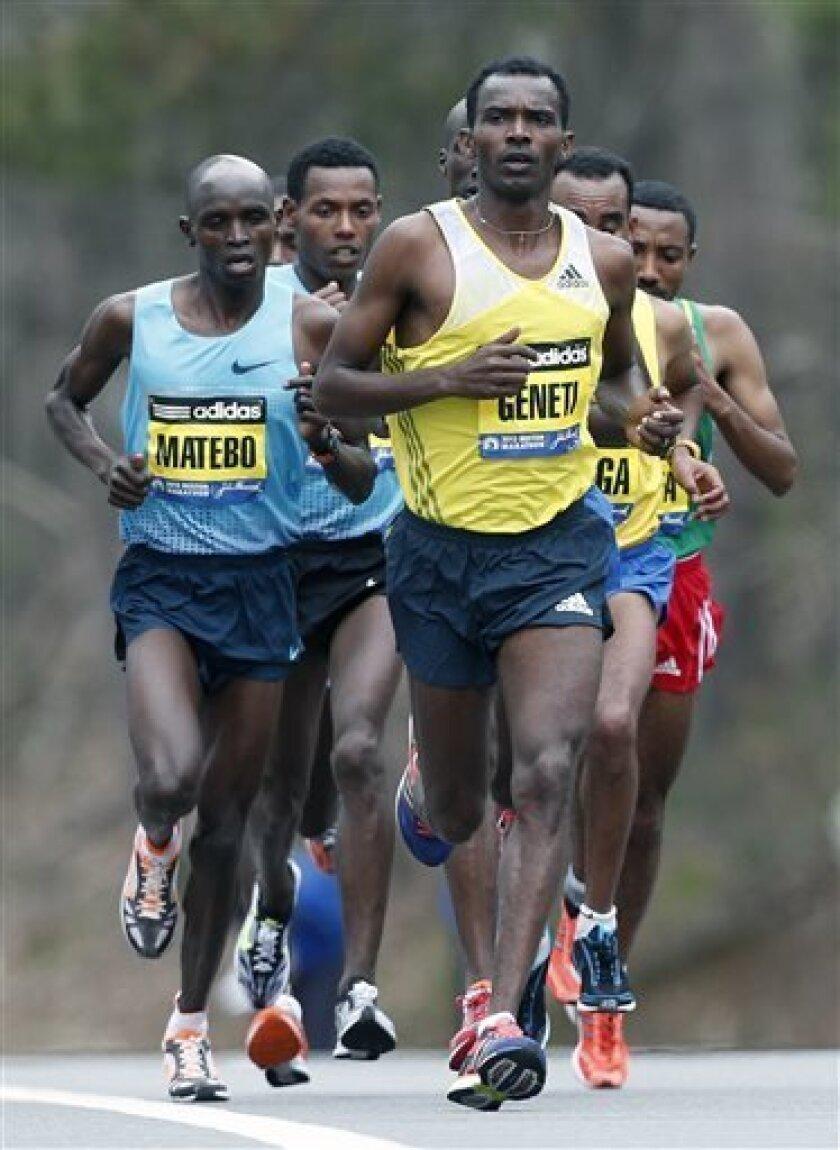 Elite mens marathoners including Levy Matebo, left, and Markos Geneti, right, run in the 117th Boston Marathon in Wellesley, Mass., Monday, April 15, 2013. (AP Photo/Michael Dwyer)