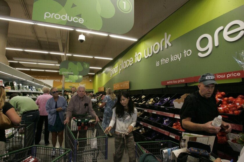 U-T FILE: In this 2008 file photo shoppers scooped up bargains at a newly opened Fresh and Easy in Point Loma.  Five years later three stores are liquidating inventories to close.