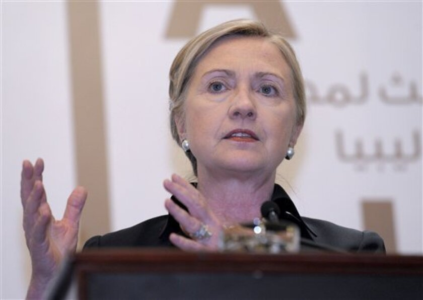 Secretary of State Hillary Rodham Clinton speaks during a news conference at the Emirates Palace Hotel in Abu Dhabi, United Arab Emirates, Thursday, June 9, 2011, following the Third Contact Group Meeting on Libya. (AP Photo/Susan Walsh, Pool)