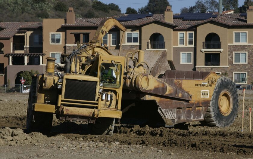 Design and construction of new homes remain slow, but infill projects like Civita, seen here in the early grading stage in Mission Valley, are doing better than suburban sites, architects report.