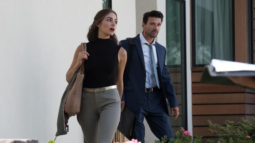 """Olivia Culpo and Frank Grillo in the movie """"Reprisal."""""""