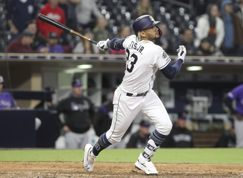 Padres rookie Fernando Tatis Jr. hits a double in the ninth inning on Tuesday.