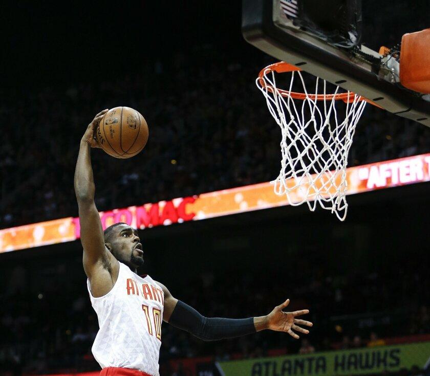 Atlanta Hawks guard Tim Hardaway Jr. (10) scores in the first half of an NBA basketball game against the Houston Rockets Saturday, March 19, 2016, in Atlanta. (AP Photo/John Bazemore)