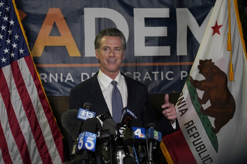 California Gov. Gavin Newsom addresses reporters, after beating back the recall attempt