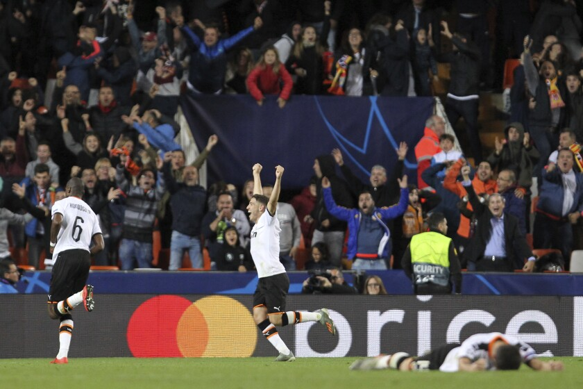 Valencia's players celebrate a goal during the Champions League group H soccer match between Valencia and Lille at the Mestalla stadium in Valencia, Spain, Tuesday, Nov. 5, 2019. (AP Photo/Alberto Saiz)