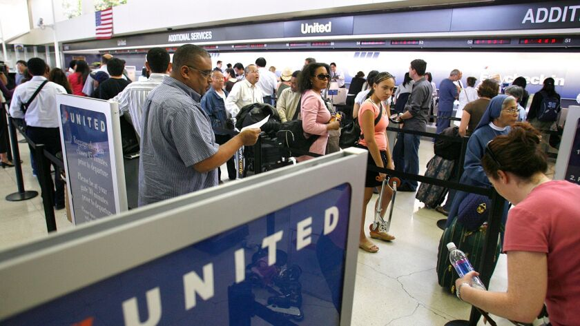 Passengers wait in line to check-in at the United terminal at LAX Wednesday June 20, 2007. United A