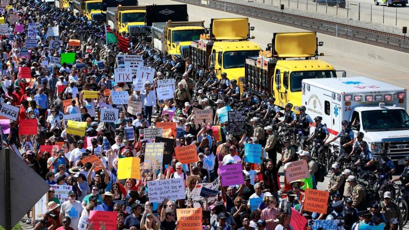 Protesters shut down the Dan Ryan Expressway during an anti-violence protest calling for commonsense gun laws on Saturday, July 7, 2018, in Chicago.