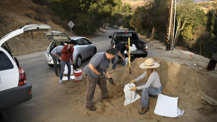 Kagel Canyon residents fill sand bags at the local fire station before a storm hits the Creek fire burn area.