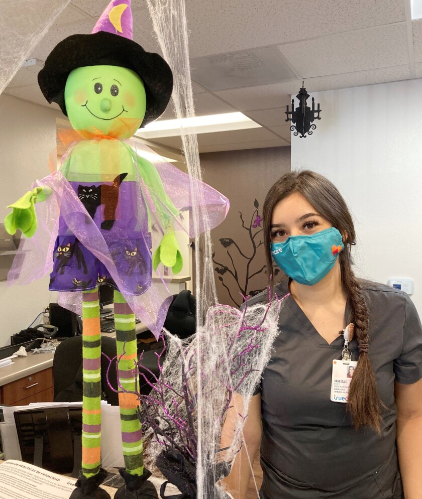 TrueCare receptionist Vanessa Cortez wears a mask to celebrate Halloween safely. TrueCare offers mask guidance amid COVID-19.