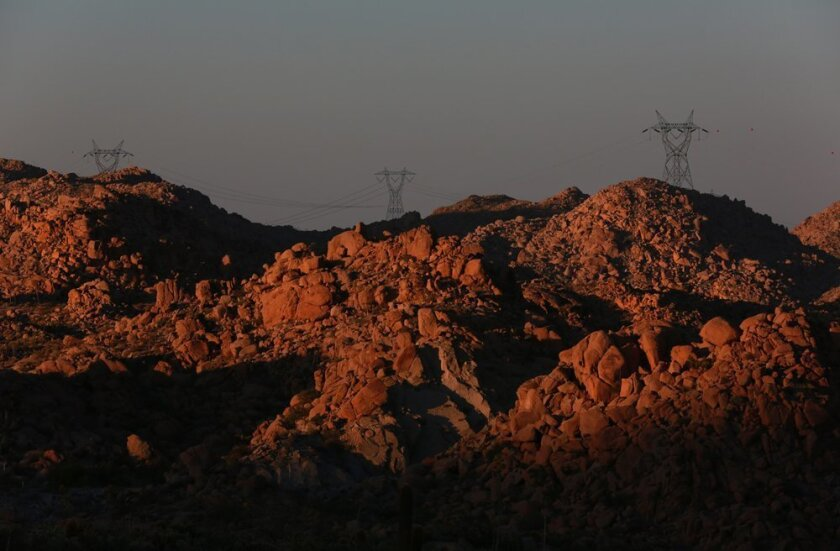 The sprawling open desert now topped with transmission towers amid the long shadows of twilight in the Desert View corridor above Ocotillo in June 2013.