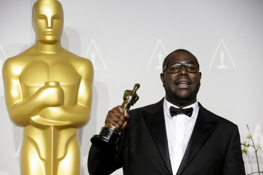 Director Steve McQueen holds the best picture Oscar statuette backstage at the Dolby Theatre on Sunday. Slavery, the director said a few days before the Oscars, was ¿horrendous, violent, vicious, nasty¿ and ¿it¿s understandable that people had difficulty coming to terms with it or visualizing it via cinema.""