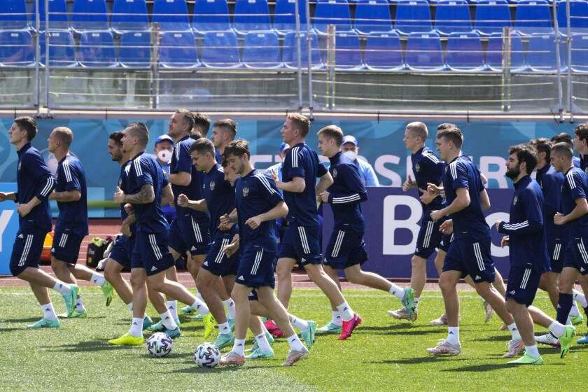 Russia players warm up during a training session of the national team at Petrovsky stadium in St. Petersburg, Russia, Friday, June 11, 2021, on the eve of the Euro 2020 soccer championship group B match between Russia and Belgium. The Euro 2020 gets underway on Friday June 11 and is being played in 11 host cities across 11 countries. The event was delayed by one year after being postponed in 2020 due to the COVID-19 pandemic. (AP Photo/Dmitri Lovetsky)