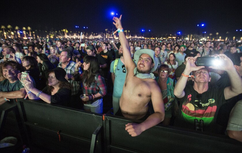 Fans cheer as the Rolling Stones take the stage at Desert Trip in Indio on Friday.