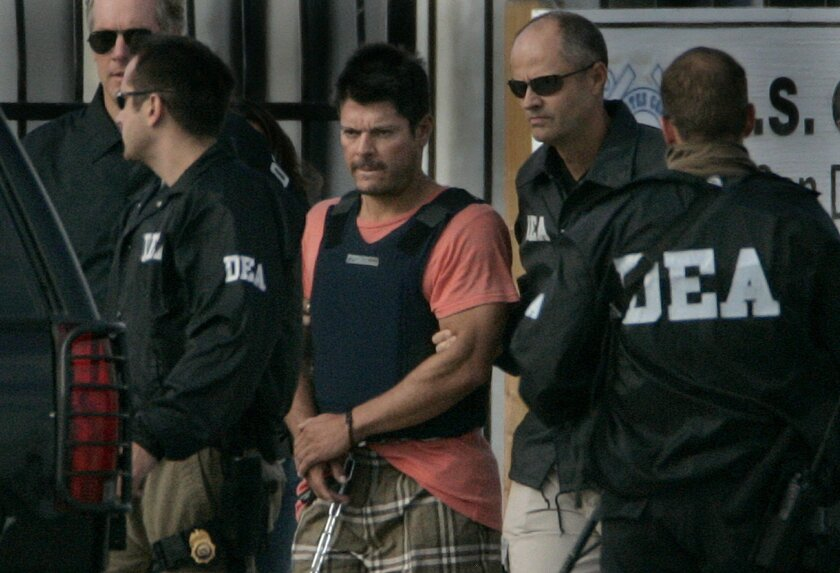 Francisco Javier Arellano Félix, leader of a Mexican drug cartel, is taken from a Coast Guard vessel at the San Diego Coast Guard Station. U-T file photo