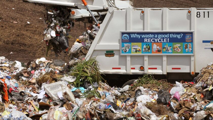 August 17, 2012, San Diego, California, USA_|A City of San Diego garbage truck dumps its load at the
