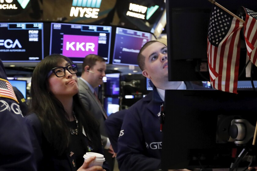 Specialist Erica Fredrickson and a colleague on the floor of the New York Stock Exchange on Monday