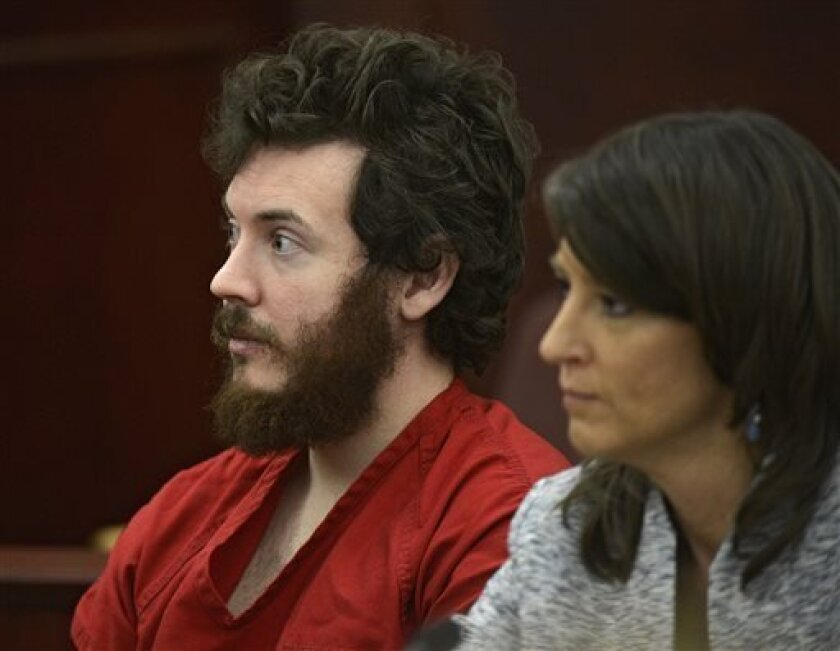 FILE - In this March 12, 2013 file photo, James Holmes, left, and defense attorney Tamara Brady appear in district court in Centennial, Colo. for his arraignment. Prosecutors say they are not are ready to accept an offer from Colorado theater shooting suspect James Holmes to plead guilty in exchange for avoiding the death penalty. In a court filing Thursday, March 28, 2013 prosecutors criticized defense attorneys for publicizing Holmes' offer to plead guilty. (AP Photo/The Denver Post, RJ Sangos