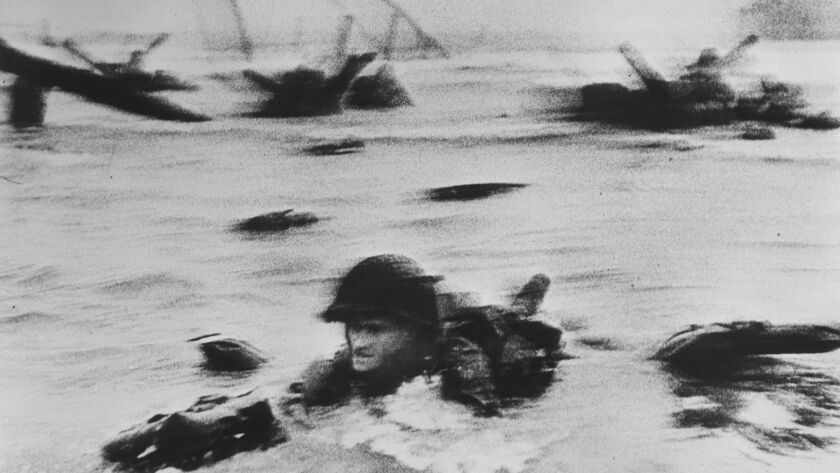 American troops land at Omaha Beach on D-day, June 6, 1944.