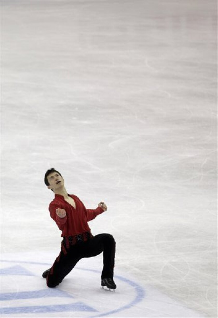Patrick Chan of Canada reacts after performing his men's free skating program at the 2012 World Figure skating Championships in Nice, southern France, Saturday, March 31, 2012. (AP Photo/Lionel Cironneau)