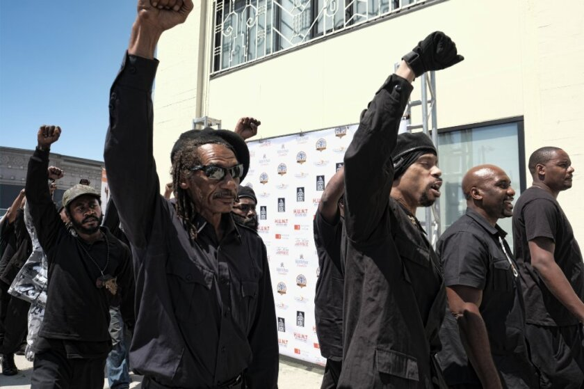 """Marchers calling themselves a new generation of the Black Panther Party gather in Los Angeles on July 17 for a community summit titled """"Time to Unite: United Hoods + Gangs Nation."""""""