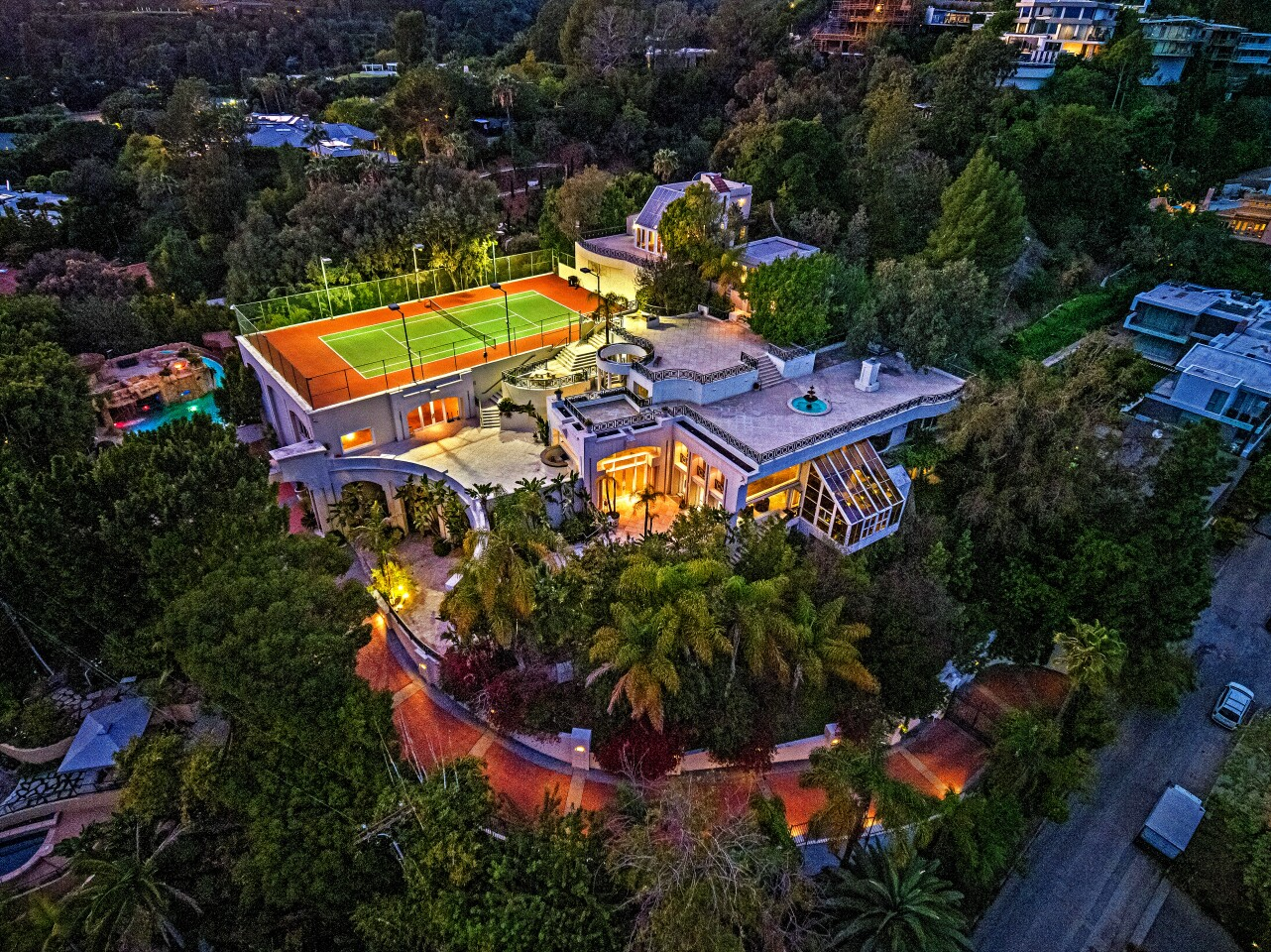 Built by contractor and noted playboy Hal B. Hayes in the 1950s, the 18,000-square-foot mansion was built to withstand a nuclear blast and features a sealed underground cave accessed by an underwater tunnel. In the 2000s, the home was owned by former NBA player Carlos Boozer, who leased the property to the late pop star Prince. It's now for sale at about $30 million. Boozer later sued Prince for damages after the pop star renovated the home and added a heart-shaped bed in the master bedroom as well as a hair salon in a spare bedroom. Italian carpets were replaced with shades of purple and black. (The Oppenheim Group)