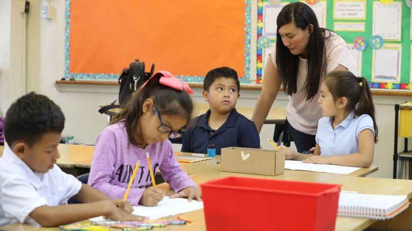 LOS ANGELES, CALIF. -- WEDNESDAY, SEPTEMBER 5, 2018: Second grade teacher Roxana Okamoto helps secon