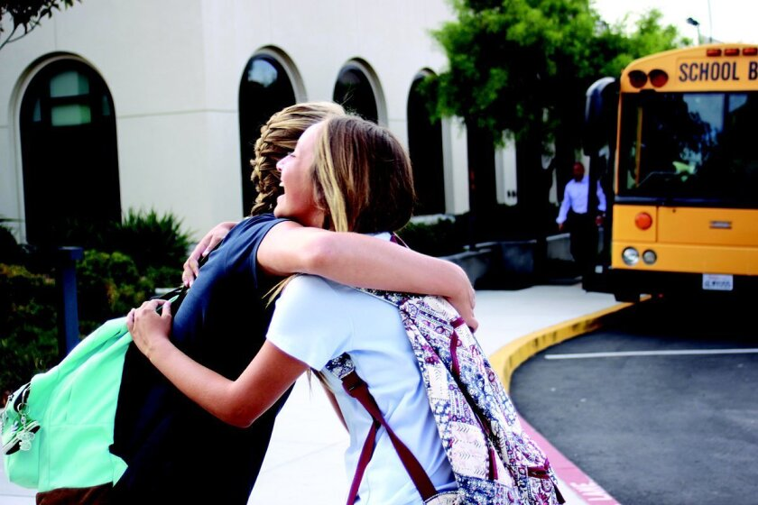 Kate Rothman and Maddie Clough hug it out on the first day.
