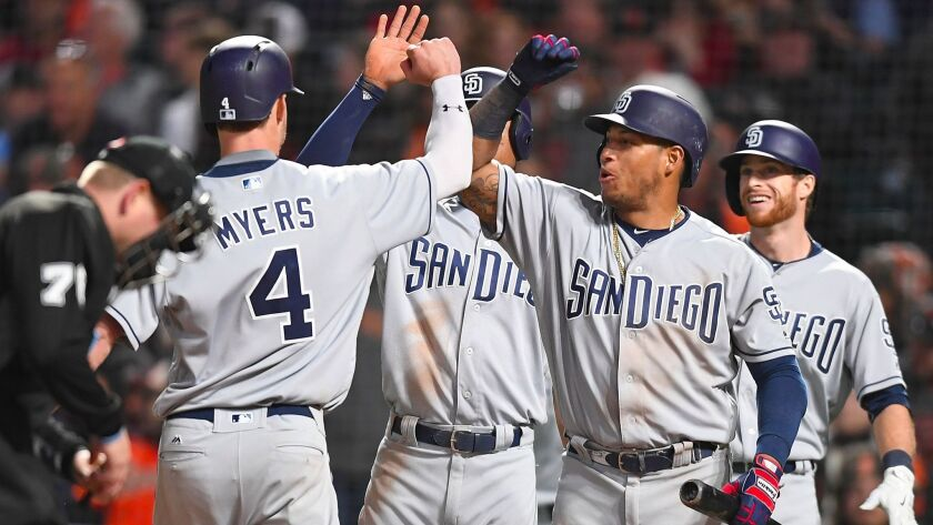 Wil Myers of the San Diego Padres is congratulated by teammates after he hit a three-run homer against the San Francisco Giants in the top of the six inning at AT&T Park on April 29, 2017, in San Francisco, California.
