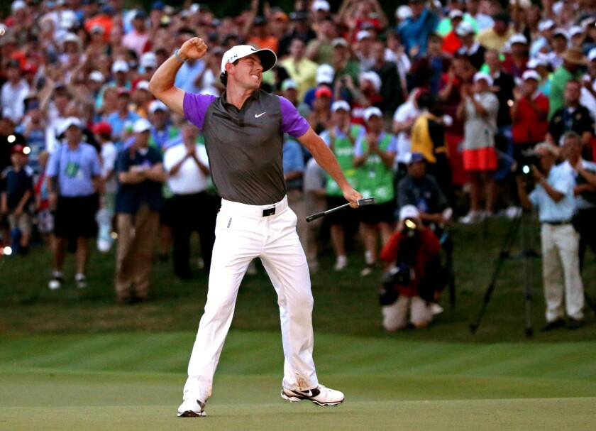 Rory McIlroy of Northern Ireland celebrates his one-stroke victory on the 18th green during the final round of the 96th PGA Championship at Valhalla Golf Club on Sunday in Louisville, Ky.