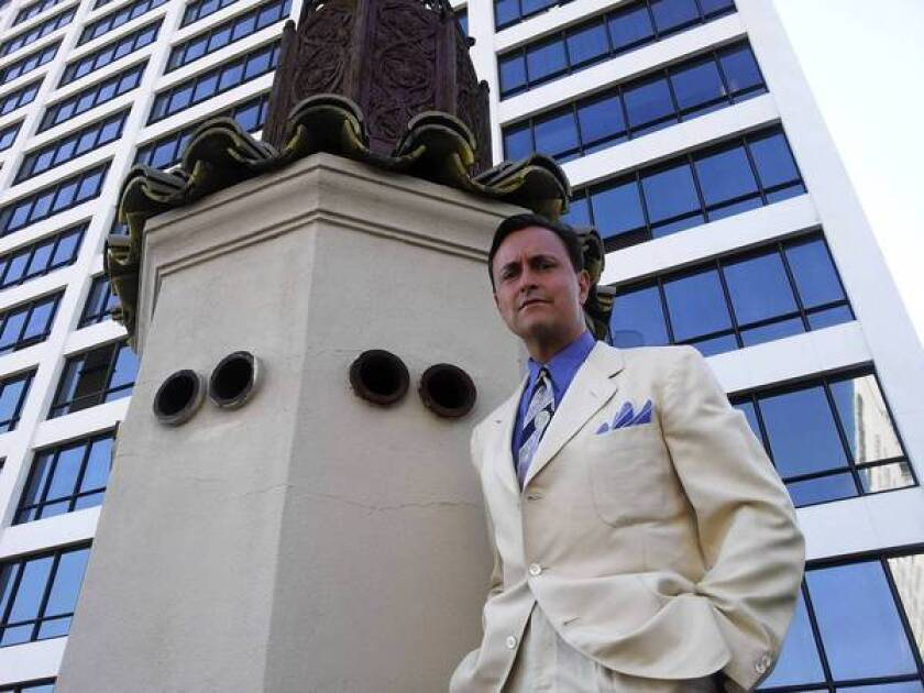 """Marc Chevalier stands on the roof of the Oviatt Building. """"What really attracts me to him,"""" Chevalier says of its builder, clothier James Oviatt, """"is that he had one religion — the best. He wanted to find the best, make the best and sell the best."""""""