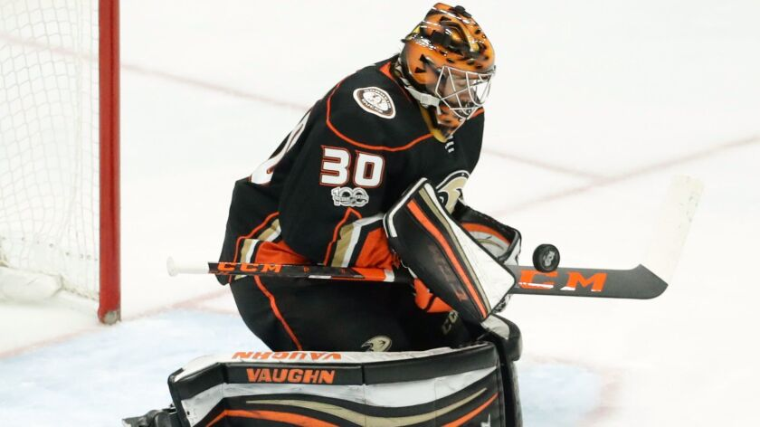 Anaheim Ducks goalie Ryan Miller blocks a shot by the Vancouver Canucks during the third period of a