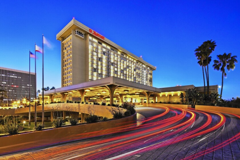 The Los Angeles Airport Marriott, which sold for $160 million, has 1,004 rooms in 18 stories. The buyer is expected to make about $35 million worth of improvements.