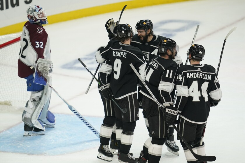 Kings forward Adrian Kempe celebrates with teammates after scoring in the third period of a 4-2 win.