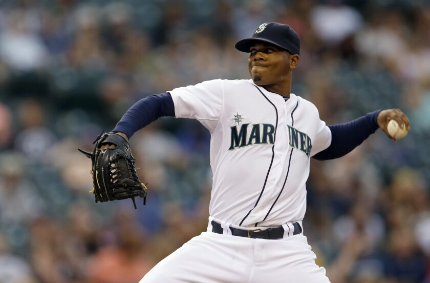 Seattle Mariners starting pitcher Roenis Elias throws against the Chicago White Sox in the fourth inning of a baseball game, Thursday, Aug. 7, 2014, in Seattle. (AP Photo/Ted S. Warren)