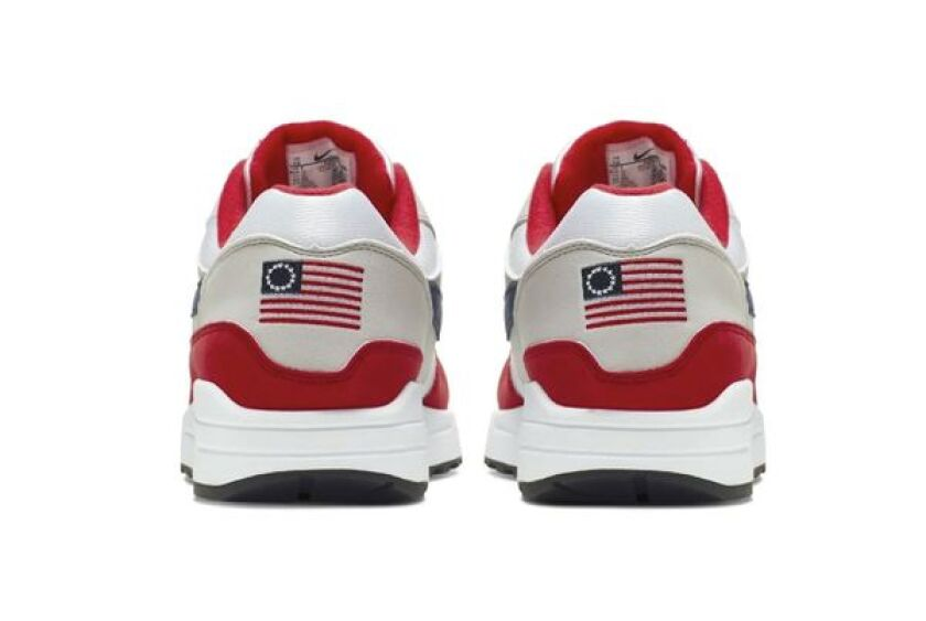 This undated product image obtained by the Associated Press shows Nike Air Max 1 Quick Strike Fourth of July shoes that have a U.S. flag with 13 white stars in a circle on it, known as the Betsy Ross flag, on them.
