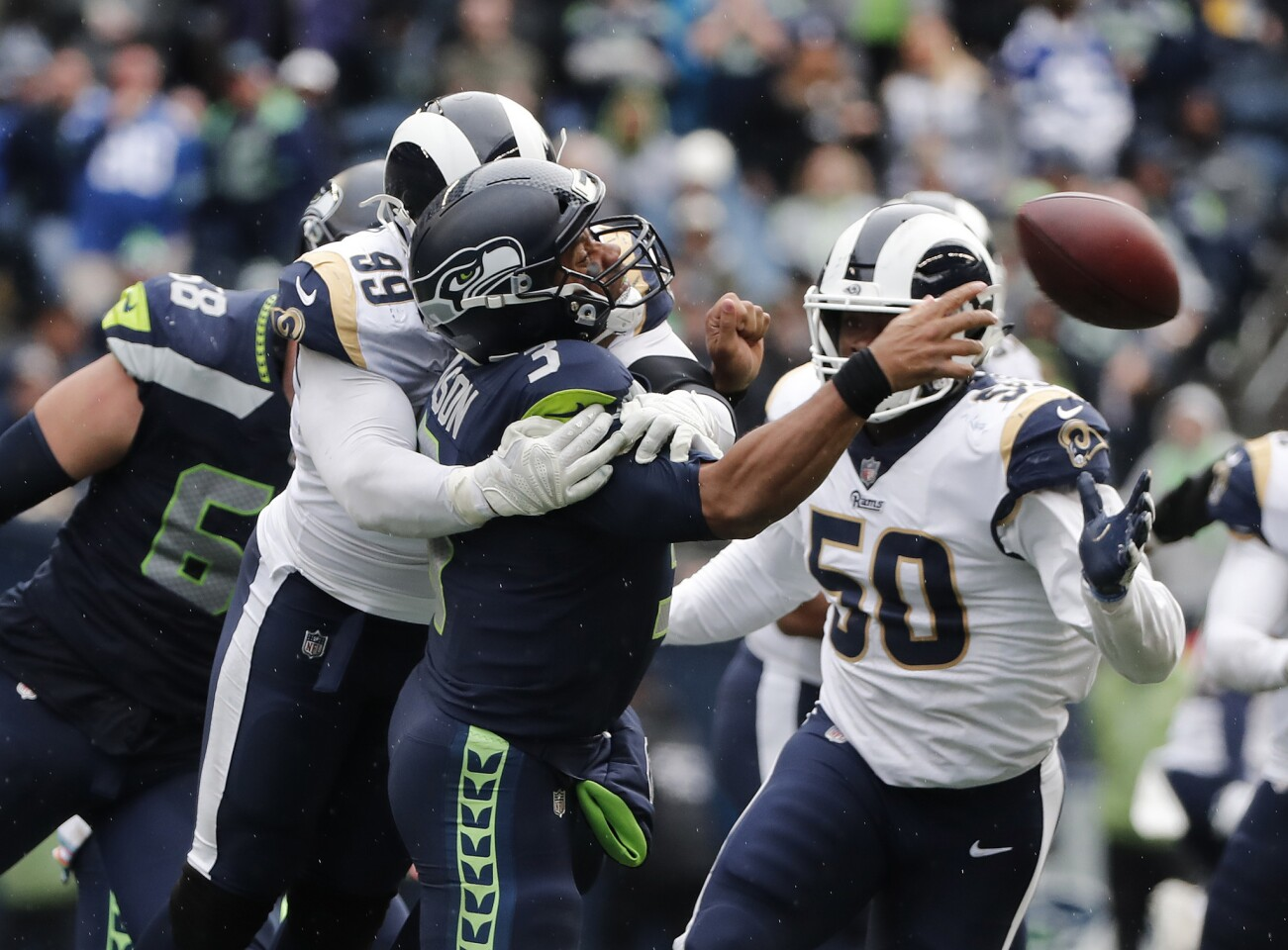 Rams defensive tackle Aaron Donald (99) sacks Seattle Seahawks quarterback Russell Wilson (3) in the second half at CenturyLink Field on Sunday in Seattle.