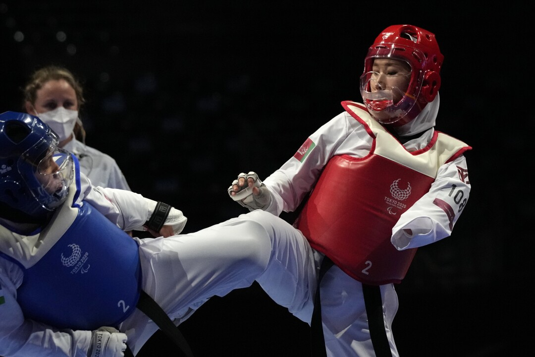 Afghanistan's Zakia Khudadadi competes against Ziyodakhon Isakova of Uzbekistan during their taekwondo match.