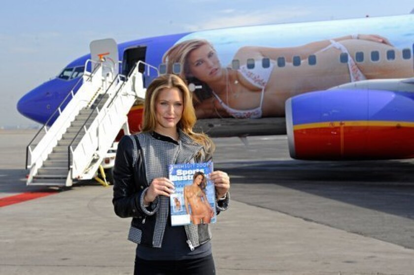 """Sports Illustrated swimsuit edition cover model Bar Rafaeli recently got her wings, courtesy of Southwest Airlines, which has draped her teensy-weensy-bikinied body over the fuselage of a 737 jet, renamed """"S.I. One."""""""