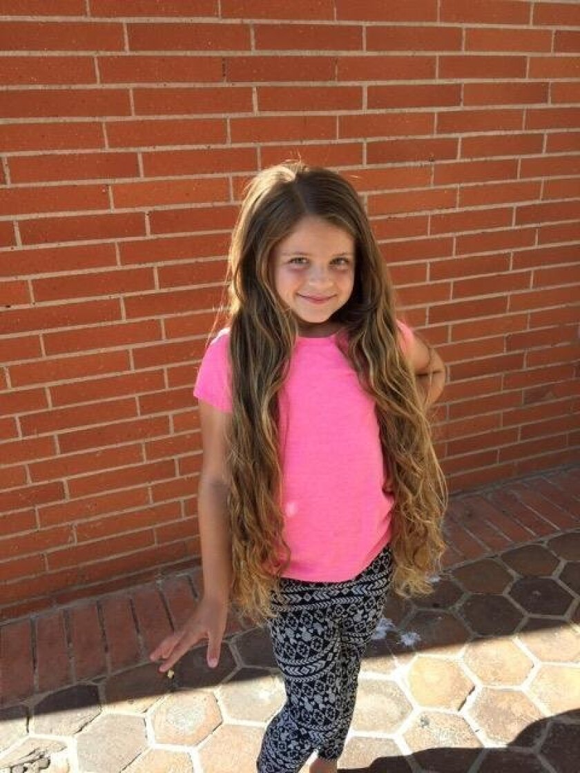 Six-year-old Ryder Perryman before her hair donation at La Jolla-based Koda Salon