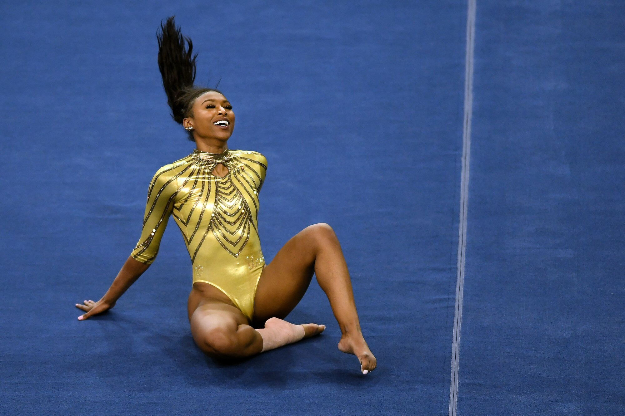 UCLA's Nia Dennis competes on the floor against BYU at Pauley Pavillion on Feb. 10.