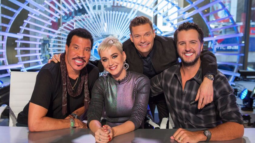 This image released by ABC shows, from left, Lionel Richie, Katy Perry, Ryan Seacrest and Luke Bryan