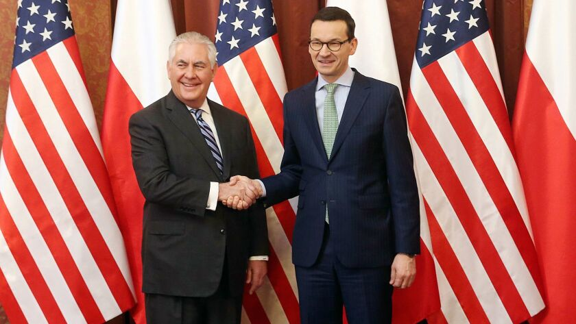 Secretary of State Rex Tillerson, left, shakes hands with Polish Prime Minister Mateusz Morawiecki.